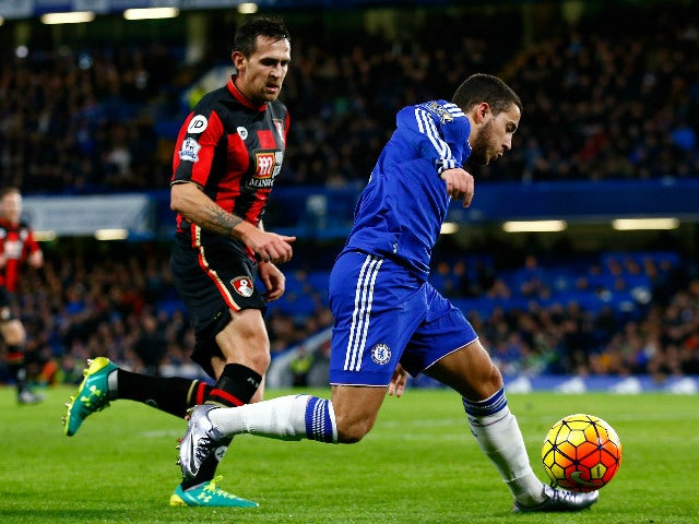 Eden Hazard of Chelsea and Charlie Daniels of Bournemouth compete for the ball during the Barclays Premier League match between Chelsea and A.F.C. Bournemouth at Stamford Bridge on December 5, 2015 in London, England.