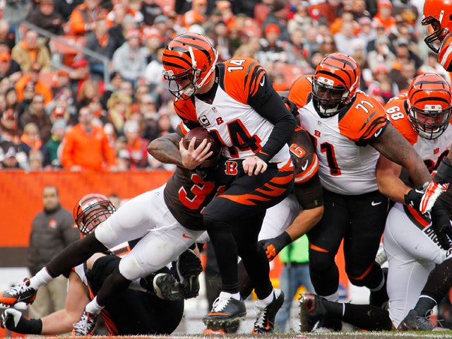 Andy Dalton #14 of the Cincinnati Bengals runs for a first quarter touchdown while playing the Cleveland Browns at FirstEnergy Stadium on December 6, 2015