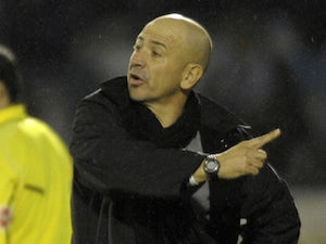 Ponferradina's coach Claudio Barragan gestures during their Spanish Cup football match against Real Madrid at El Toralin Stadium in Ponferrada, on december 13, 2011. Real Madrid won the match 2-0.