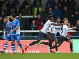 Danny Rose of Bury celebrates with team mates after scoring the opening goal during The Emirates FA Cup Second Round match between Rochdale and Bury at Spotland on December 6, 2015 in Rochdale, England.