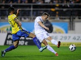 Denis Cheryshev of Real Madrid shoots past Cristian Marquez of Cadiz to score his team's opening goal during the Copa del Rey Round of 32 First Leg match between Cadiz and Real Madrid at Ramon de Carranza stadium on December 2, 2015 in Cadiz, Spain
