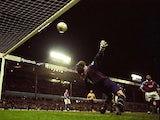 Dion Dublin of Aston Villa beats David Seaman of Arsenal to score the winner in the FA Carling Premiership match at Villa Park in Birmingham, England. Villa won 3-2.
