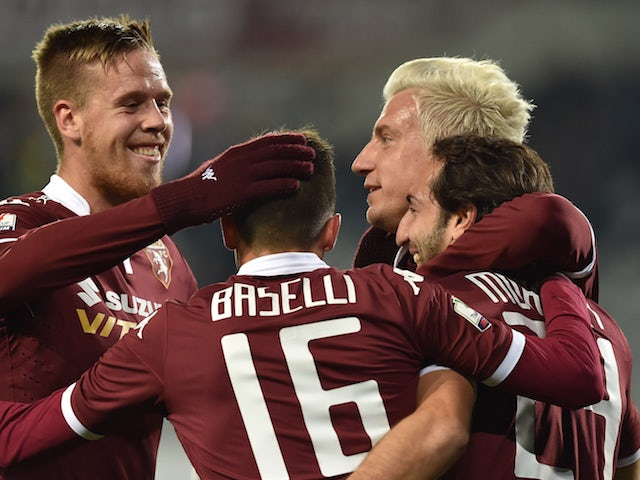 Emiliano Moretti (R) of Torino FC celebrates a goal with team mates during the TIM Cup match between Torino FC and AC Cesena at Stadio Olimpico di Torino on December 1, 2015 in Turin, Italy.