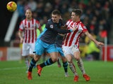 Gary Hooper of Sheffield Wednesday and Marco van Ginkel of Stoke City during the Capital One Cup match between Stoke City and Sheffield Wednesday at the Britannia Stadium on December 1, 2015 in Stoke-on-Trent, England.