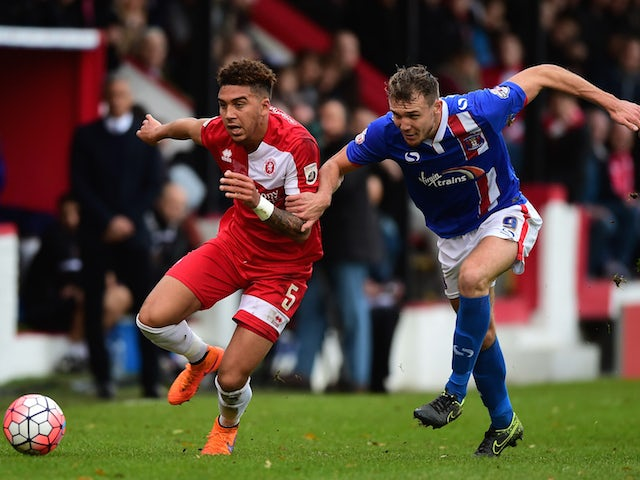 Harry Osborne of Welling United (L) battles for the ball with Charlie Wyke of Carlisle United during the Emirates FA Cup Second Round match between Welling United and Carlisle United at Park View Road on December 6, 2015 in Welling, England.