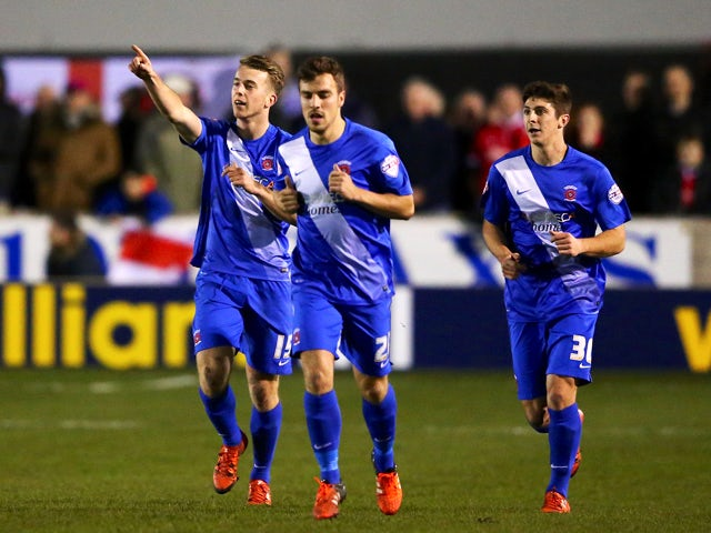 Rhys Oates of Hartlepool United (L) celebrates scoring his side's first goal from the penalty spot during the Emirates FA Cup Second Round match between Salford City and Hartlepool United at Moor Lane on December 4, 2015