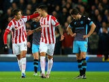 Ibrahim Afellay of Stoke City (L) celebrates his goal with Joselu of Stoke City during the Capital One Cup match between Stoke City and Sheffield Wednesday at the Britannia Stadium on December 1, 2015 in Stoke-on-Trent, England.