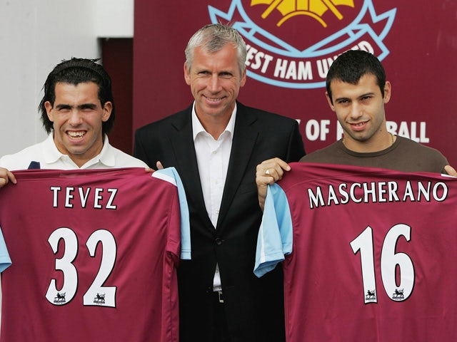 Carlos Tevez, West Ham manager Alan Pardew and Javier Mascherano pose with their squad numbers during a West Ham United press conference to unveil the new signings at Upton Park on September 5, 2006