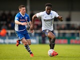 Joe Dodoo of Bury beats Donal McDermott of Rochdale during The Emirates FA Cup Second Round match between Rochdale and Bury at Spotland on December 6, 2015 in Rochdale, England.