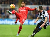 Jordon Ibe of Liverpool takes on Paul Dummett of Newcastle United during the Barclays Premier League match between Newcastle United and Liverpool at St James' Park on December 6, 2015 in Newcastle upon Tyne, England