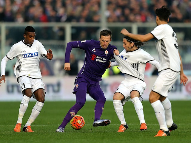 Josip Ilicic of ACF Fiorentina battles for the ball with Edenilson (L) and Manel Iturra (R) of Udinese Calcio during the Serie A match between ACF Fiorentina and Udinese Calcio at Stadio Artemio Franchi on December 6, 2015 in Florence, Italy.