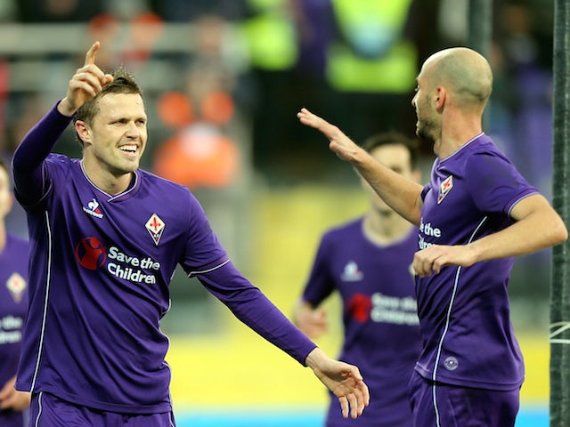 Josip Ilicic of ACF Fiorentina celebrates after scoring a goal during the Serie A match between ACF Fiorentina and Udinese Calcio at Stadio Artemio Franchi on December 6, 2015 in Florence, Italy.