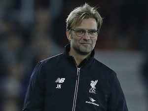 Liverpool's German manager Jurgen Klopp holds the drinks bottles as he stands on the touchline during the English League Cup quarter-final football match between Southampton and Liverpool at St Mary's Stadium in Southampton, southern England on December 2