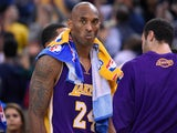 Kobe Bryant #24 of the Los Angeles Lakers looks on while there's a break during the game against against the Golden State Warriors at ORACLE Arena on November 24, 2015 in Oakland, California.