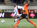 Lorient's French defender Lamine Kone (R) vies for the ball with Nice's French forward Alexandre Mendy during the French L1 football match between Lorient (FCL) and Nice (OGCN) on December 1, 2015, at the Moustoir Stadium in Lorient, western France.