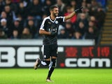 Riyad Mahrez of Leicester City celebrates scoring his team's first goal during the Barclays Premier League match between Swansea City and Leicester City at Liberty Stadium on December 5, 2015