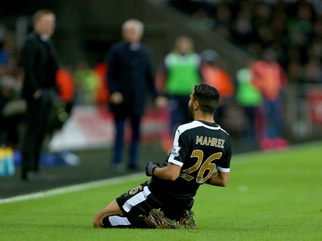 Leicester City's Algerian midfielder Riyad Mahrez celebrates after he scored his second goal during the English Premier League football match between Swansea City and Leicester City at The Liberty Stadium in Swansea, south Wales on December 5, 2015