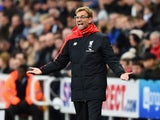 Jurgen Klopp manager of Liverpool gestures during the Barclays Premier League match between Newcastle United and Liverpool at St James' Park on December 6, 2015