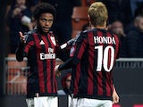 Luiz Adriano (L) of AC Milan celebrates with his team-mate Keisuke Honda (R) after scoring the opening goal during the TIM Cup match between AC Milan and FC Crotone at Stadio Giuseppe Meazza on December 1, 2015 in Milan, Italy.