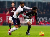 Luiz Adriano (R) of AC Milan is challenged by Gian Marco Ferrari (L) of FC Crotone during the TIM Cup match between AC Milan and FC Crotone at Stadio Giuseppe Meazza on December 1, 2015 in Milan, Italy.
