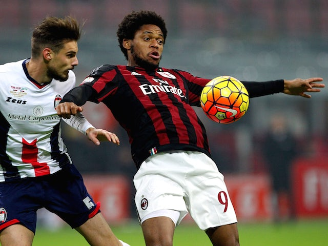 Luiz Adriano (R) of AC Milan is challenged by Michele Cremonesi (L) of FC Crotone during the TIM Cup match between AC Milan and FC Crotone at Stadio Giuseppe Meazza on December 1, 2015 in Milan, Italy.