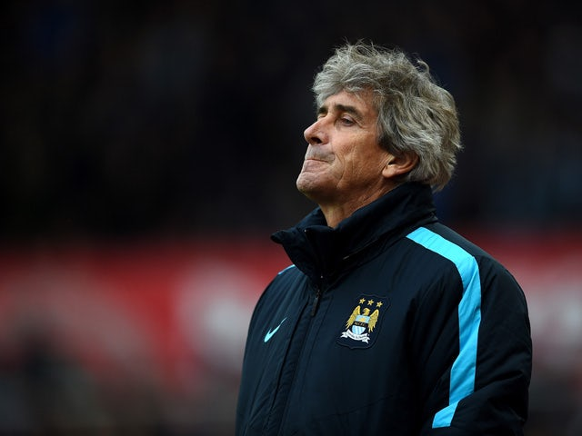 Manuel Pellegrini, manager of Manchester City looks on during the Barclays Premier League match between Stoke City and Manchester City at Britannia Stadium on December 5, 2015