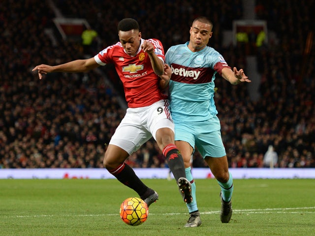 Manchester United's French striker Anthony Martial (L) vies with West Ham United's New Zealand defender Winston Reid during the English Premier League football match between Manchester United and West Ham United at Old Trafford in Manchester, north west E