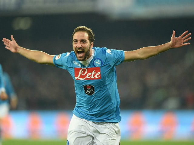 Gonzalo Higuain of Napoli celebrates after scoring goal 1-0 during the Serie A match between SSC Napoli and FC Internazionale Milano at Stadio San Paolo on November 30, 2015 in Naples, Italy.