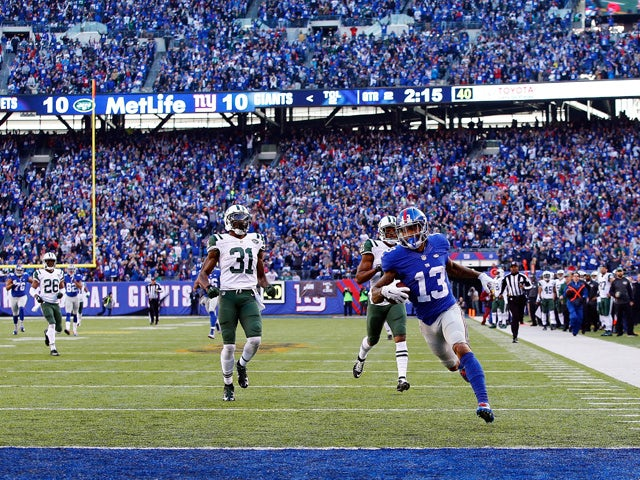 Odell Beckham Jr. #13 of the New York Giants runs with the ball on his way to scoring a 72 yard long touchdown against Marcus Gilchrist #21 and the New York Jets at MetLife Stadium on December 6, 2015