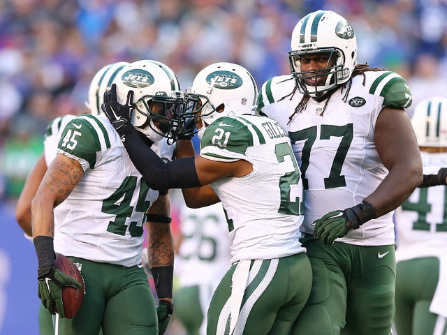 Rontez Miles #45 of the New York Jets celebrates after intercepting the ball in the fourth quarter against the New York Giants at MetLife Stadium on December 6, 2015