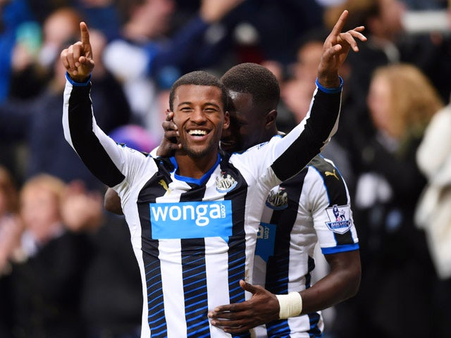 Georginio Wijnaldum of Newcastle United (L) celebrates with Moussa Sissoko as he scores their second goal during the Barclays Premier League match between Newcastle United and Liverpool at St James' Park on December 6, 2015