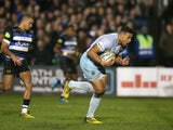 Luther Burrell of Northampton breaks away from Jonathan Joseph to score an interception try during the Aviva Premiership match between Bath and Northampton Saints at the Recreation Ground on December 5, 2015