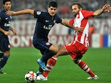 Arsenal's Fran Merida (L) vies for the ball with Olympiacos' Olof Mellberg during their UEFA Champions League football game at the Karaiskaki stadium in Athens on December 9, 2009.
