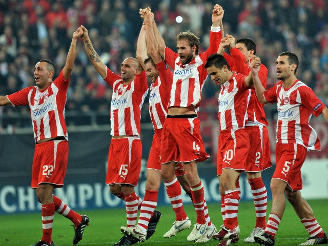 Players of Olympiacos Piraeus celebrate their victory against Arsenal during their Champions league match at the Karaiskaki stadium in Piraeus near Athens on December 9, 2009. Olympiacos won 1-0.