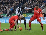 Newcastle United's Senegalese striker Papiss Cisse (2R) vies with Liverpool's English defender Nathaniel Clyne (R) and Liverpool's Slovakian defender Martin Skrtel (2L) during the English Premier League football match between Newcastle United and Liverpoo