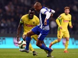 Porto's Algerian midfielder Yacine Brahimi (C) vies with Pacos de Ferreira's midfielder Pele (L) during the Portuguese league football match FC Porto vs FC Pacos de Ferreira at the Dragao stadium in Porto on December 5, 2015.