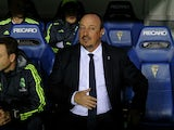 Real Madrid's coach Rafael Benitez (C) looks on before the Spanish Copa del Rey (King's Cup) football match Cadiz CF vs Real Madrid at the Ramon de Carranza in Cadiz on December 2, 2015.