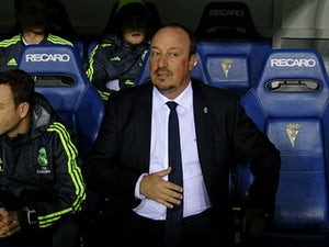 Real Madrid's coach Rafael Benitez (C) looks on before the Spanish Copa del Rey (King's Cup) football match Cadiz CF vs Real Madrid at the Ramon de Carranza in Cadiz on December 2, 2015.