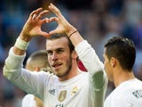 Real Madrid's Welsh forward Gareth Bale gestures as he celebrates a goal during the Spanish league football match Real Madrid CF vs Getafe CF at the Santiago Bernabeu stadium in Madrid on December 5, 2015