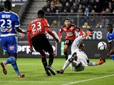 Rennes' French forward Ousmane Dembele (C) kicks the ball during the French L1 football match Rennes against Marseille on December 03, 2015