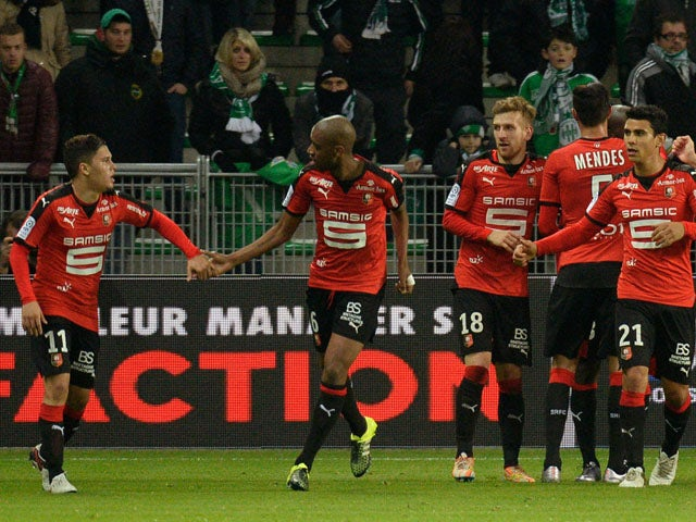 Rennes' players celebrate after scoring a goal during the French L1 football match between Saint-Etienne and Rennes at the Geoffroy Guichard Stadium in Saint-Etienne, central France, on December 6, 2015