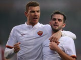 Roma's midfielder Miralem Pjanic (R) from Bosnia-Herzegovina celebrates with teammate Roma's forward from Bosnia-Herzegovina Edin Dzeko after scoring during the Italian Serie A football match Torino Vs Roma on December 5, 2015