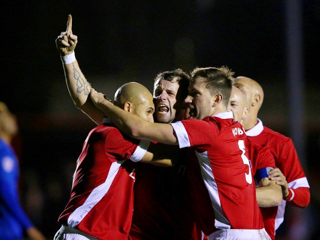 Stephen O'Halloran of Salford City (c) celebrates with his team mates after scoring his side's first goal during the Emirates FA Cup Second Round match between Salford City and Hartlepool United at Moor Lane on December 4, 2015