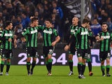 Sergio Floccari #99 of US Sassuolo Calcio celebrates their second goal with his team mate Lorenzo Pellegrini (L) during the Serie A match between UC Sampdoria and US Sassuolo Calcio at Stadio Luigi Ferraris on December 6, 2015