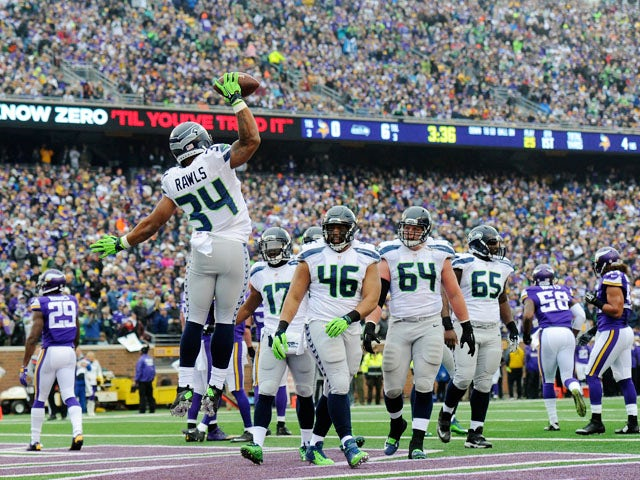 Thomas Rawls #34 of the Seattle Seahawks celebrates a touchdown against the Minnesota Vikings as his teammate look on during the first quarter of the game on December 6, 2015