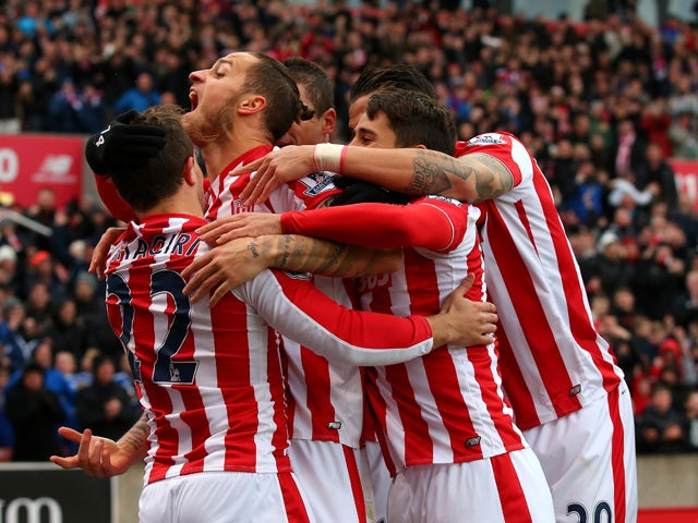 Marko Arnautovic (2nd L) of Stoke City celebrates scoring his team's first goal with his team mates during the Barclays Premier League match between Stoke City and Manchester City at Britannia Stadium on December 5, 2015
