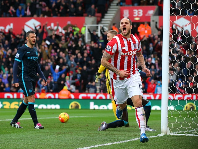 Marko Arnautovic of Stoke City celebrates scoring his team's first goal during the Barclays Premier League match between Stoke City and Manchester City at Britannia Stadium on December 5, 2015