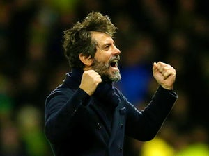 Quique Flores manager of Watford celebrates his team's second goal during the Barclays Premier League match between Watford and Norwich City at Vicarage Road on December 5, 2015