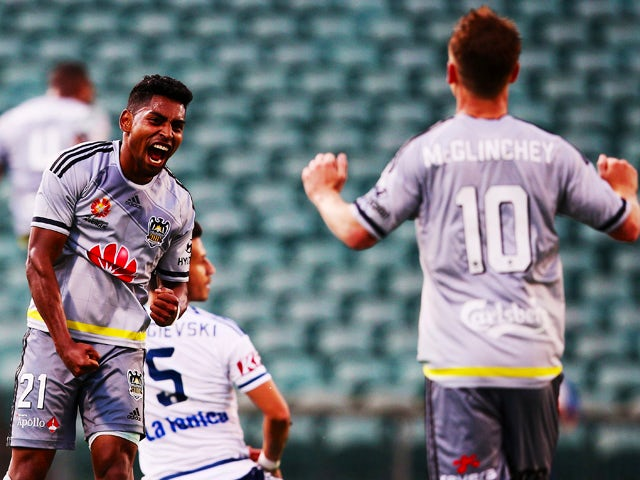 Roy Krishna of the Wellington Phoenix celebrates after Rolieny Bonevacia of the Wellington Phoenix scored attacks goal during the round nine A-League match between the Wellington Phoenix and Melbourne Victory at QBE Stadium on December 5, 2015