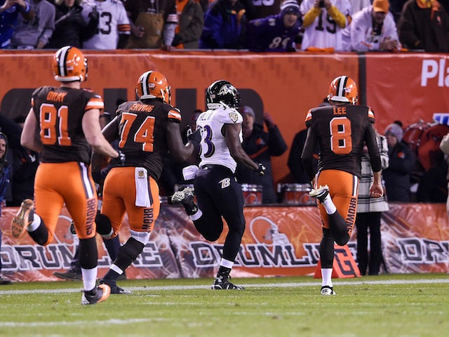 Will Hill #33 of the Baltimore Ravens returns a blocked field goal for a touchdown in front of Jim Dray #81, Cameron Erving #74 and Andy Lee #8 of the Cleveland Browns during the fourth quarter at FirstEnergy Stadium on November 30, 2015 in Cleveland, Ohi